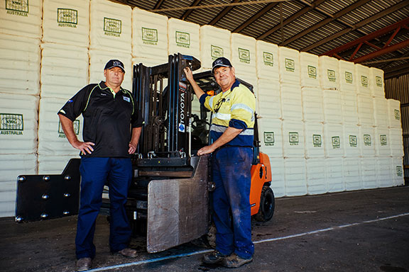 Wayne Clissold and mechanic Richard Skelton with new Toyota 8FD25 forklift.
