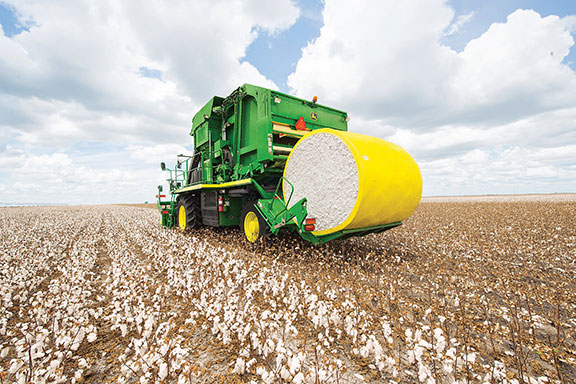 The John Deere CP690 cotton picker in a field
